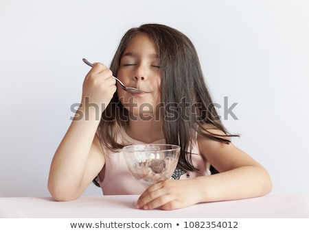 cute little kid eating ice cream and enjoying stock photo © zurijeta