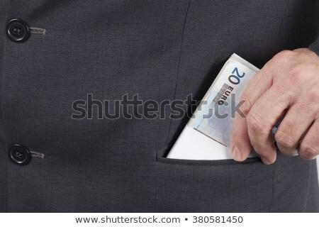 empresário · dinheiro · bolso · cinza · olhando · câmera - foto stock © stevanovicigor