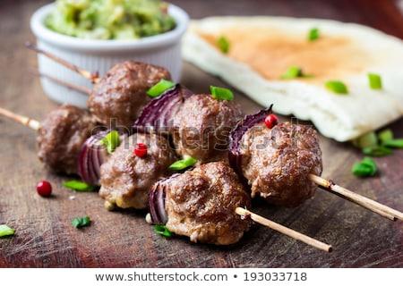 Stock photo: Grilled pork skewer and spring salad