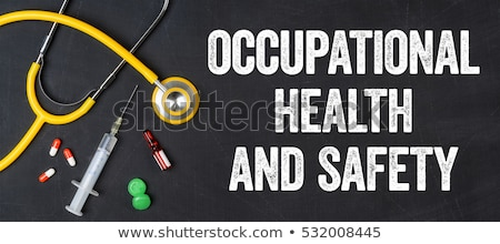 Stethoscope and pharmaceuticals on a blackboard - Occupational H Stock photo © Zerbor