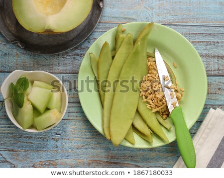Cantaloupe melon peel on rustic table Stock photo © stevanovicigor