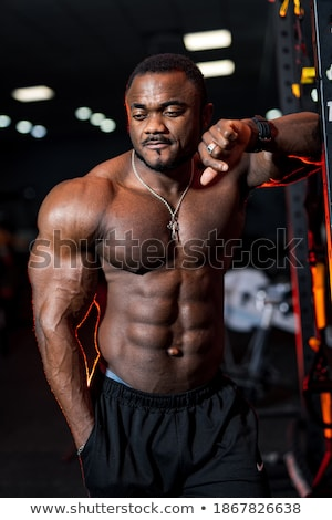 attractive young african sportsman posing stock photo © deandrobot