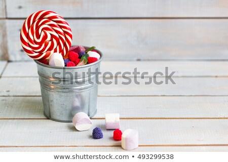 Színes cukorkák kicsi vödör fény fából készült Stock fotó © Yatsenko