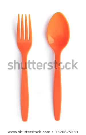 orange plastic spoon stock photo © digifoodstock
