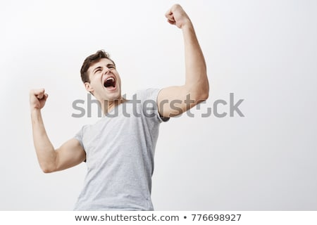 Portrait of a victorious muscular man Stock photo © majdansky