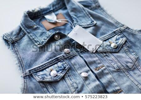 Közelkép farmer mellény ár címke ruházat Stock fotó © dolgachov