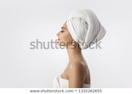 side view of a beautiful asian woman with bath towel stock photo © deandrobot