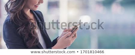 Kadın bakıyor cep telefonu iş bilgisayar ofis Stok fotoğraf © IS2