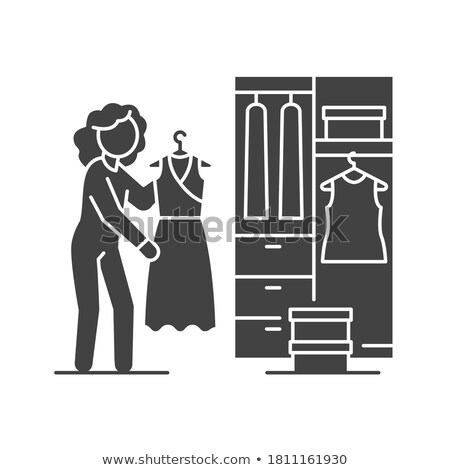 Woman in a dress in front of cupboard Stock photo © IS2