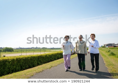 family of three walking down the road Stock photo © IS2