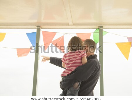 Man with child looking out past bunting Stock photo © IS2
