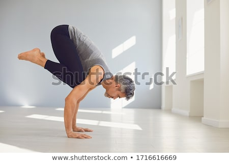 man practicing yoga stock photo © rastudio