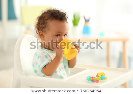 Girl drinking water from spout Stock photo © IS2