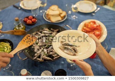 Grilled sardines and tomato on silver metal pan Stock photo © dashapetrenko