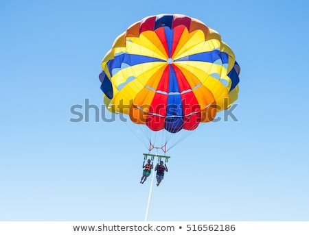 happy couple flying with parachute Stock photo © adrenalina
