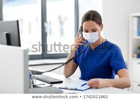 Nurse wear women_desk work stock photo © toyotoyo