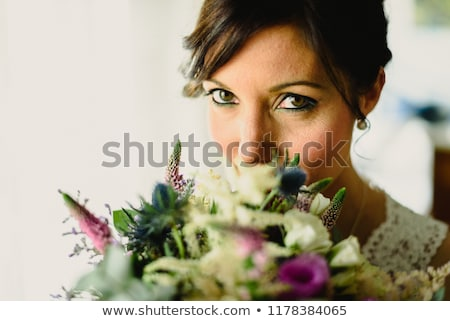 Photo stock: Quiet Bride Next To Her Bouquet Of Pretty Eyes