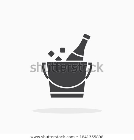 Bottle of champagne in ice bucket icon in flat style. Stock photo © MarySan