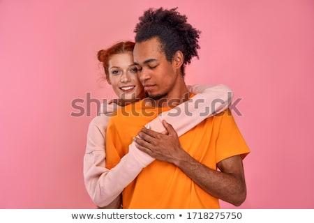 Portrait of interracial couple in love, Stock photo © artfotodima
