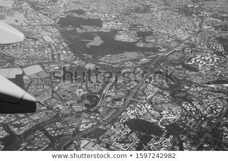 airplane flying over woods stock photo © bluering