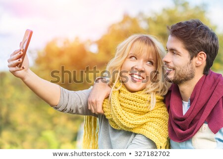 image of four hipsters men and women smiling and taking selfie stock photo © deandrobot
