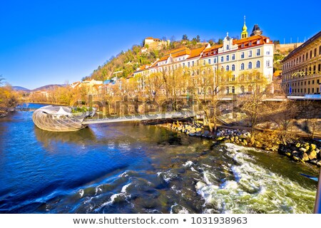 city of graz mur river island and schlossberg hill view stock photo © xbrchx