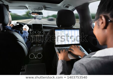 Businesswoman Examining Gantt Chart While Traveling By Car Stock photo © AndreyPopov