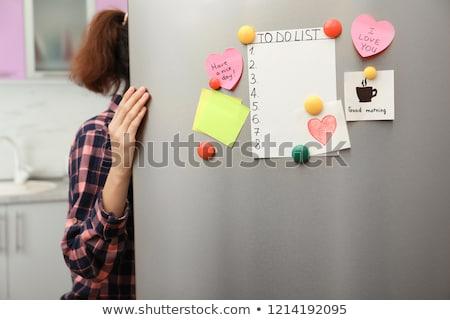 Mujer apertura refrigerador puerta alimentos Foto stock © AndreyPopov
