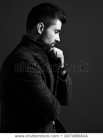 portrait of smart casual man in suit looking down to side Stock photo © feedough