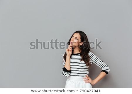 confundirse · mujer · de · negocios · posando · aislado · gris · pared - foto stock © deandrobot