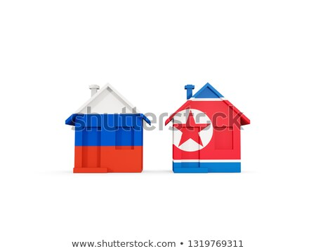 Two houses with flags of Russia and north korea Stock photo © MikhailMishchenko