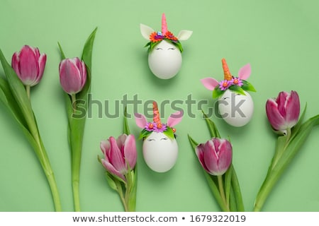 Easter background with tulip and unicorn eggs Stock photo © furmanphoto