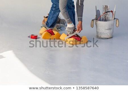 trabajador · zapatos · mojado · piscina · yeso · edificio - foto stock © feverpitch