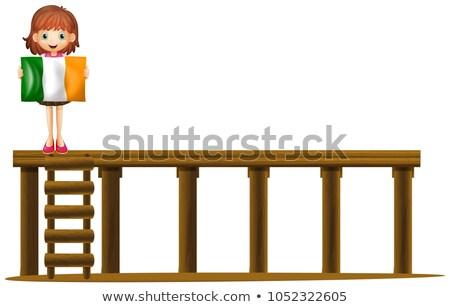 Girl holding flag of Ireland on bridge Stock photo © colematt