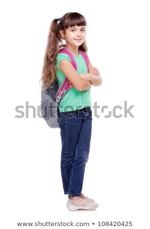 portrait of a pretty young girl with backpack standing stock photo © deandrobot