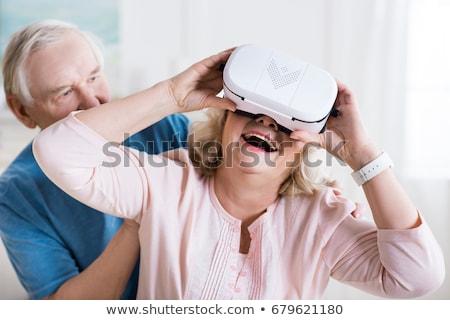 Velho caucasiano homem virtual realidade fone Foto stock © nito
