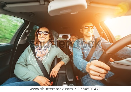 Smiling People Sitting In Car Stock photo © AndreyPopov