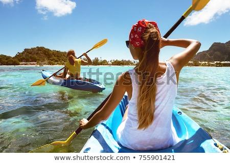 Young woman sea kayaking Stock photo © Lopolo