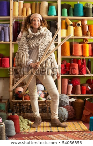 Woman Wearing Knitted Scarf Standing In Front Of Yarn Display Ho Stock photo © monkey_business