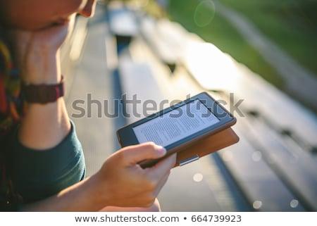 Elektronicznej książki czytelnik kobieta czytania ebook Zdjęcia stock © robuart