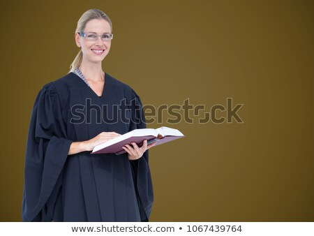 Female judge with book against green background Stock photo © wavebreak_media