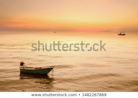 Foto stock: Small Boat In Sunrise Light