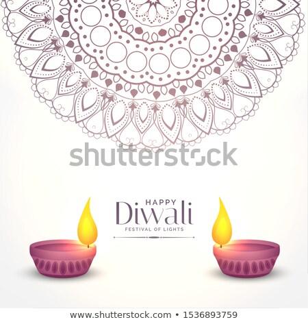 elegant white diwali background with two diya design stock photo © sarts