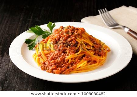 Spagetti makarna şarap domates et sos Stok fotoğraf © karandaev