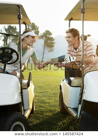 женщину говорить гольфист сидят гольф корзины Сток-фото © Kzenon