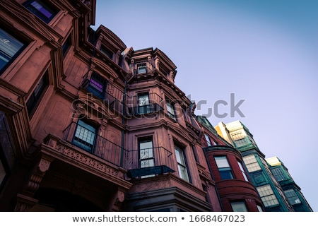 Historical buildings, restaurants and boutique stores on streets of Paris, France at night Stock photo © Anneleven