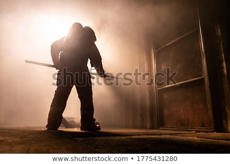 Silhouet brandweerman ontsnappen gebouw metaal haak Stockfoto © vichie81