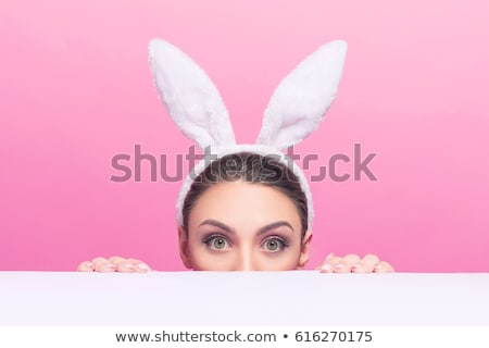 Attractive woman with bunny ears Stock photo © ivelin