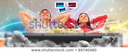 Cute paar kijken film home cinema Stockfoto © HASLOO
