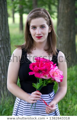 gorgeous woman playing with a red ribbon stock photo © rob_stark